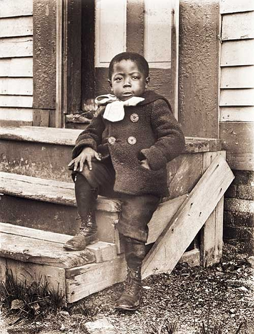 """Ralph Mendis on a Stoop,"" photographed by William Bullard about 1902; printed 2016, archival inkjet print on Epson Hot Press Natural paper; facsimile produced from glass plate negatives lent by Frank J. Morrill."