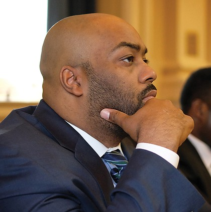 Delegate Lamont Bagby, new chair of the 20-member Virginia Legislative Black Caucus, thoughtfully watches his colleagues.