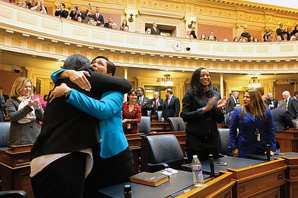 New delegates Dawn M. Adams of Richmond and Hala S. Ayala of Woodbridge share a happy embrace. They are among the 34 female legislators —  28 in the House and six in the Senate — a record for the General Assembly.