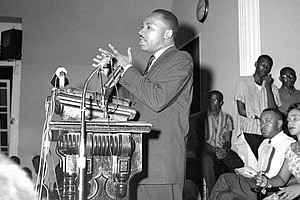 Dr. Martin Luther King Jr. talks to a standing-room-only crowd on July 13, 1962 – in one of the two African American churches where he spoke about his keen disappointment – about being released from jail, in Albany, Georgia. King was sentenced to a fine of $178 or 45 days in prison but was released after serving two days when an unidentified person paid the fine. After his release he was in conference with city officials for three hours and will meet again in an effort to settle the segregation disturbances.