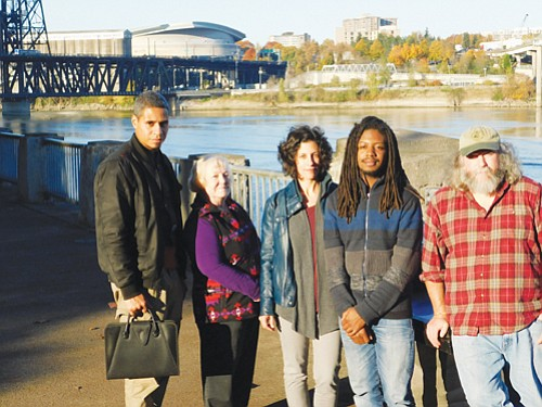 Citizen advocates representing the Portland Harbor Community Coalition apply pressure to make sure the EPA's Superfund Site cleanup plans to remove toxins in the Willamette River are carried out and benefit the community. Pictured (from left) are coalition members Rahsaan Muhammad, Jackie Calder, Cassie Cohen, Donovan Smith and Bob Sallinger.