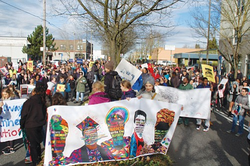 A peaceful march for freedom, unity and justice led by young people in the community in observance of the Martin ...