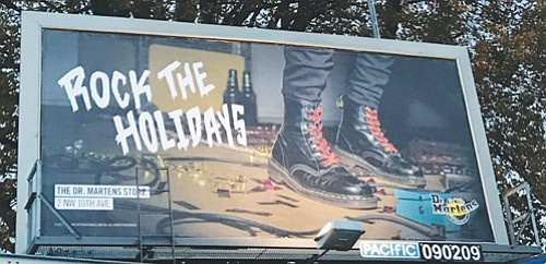 A seemingly innocuous billboard advertising Dr. Martens boots that has popped up around northeast Portland and in other locations has ...