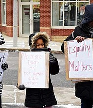 Leslie Grant and her three children at the Martin Luther King Day march on Monday.