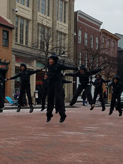 A sudden snow shower did not stop these energetic youth performers from jumping joyfully to celebrate the life and legacy of Dr. Martin Luther King, Jr.