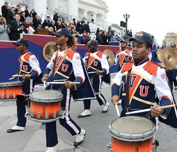 The Virginia State University Trojan Explosion Marching Band carries the beat during the 25-unit inaugural parade.