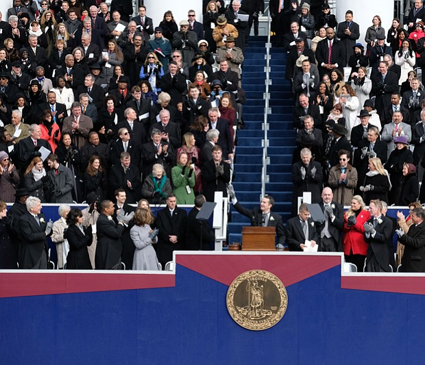 By tradition, former Gov. Terry McAuliffe, top left, slips out of the inaugural ceremony when new Gov. Ralph S. Northam takes the podium to address the crowd for the first time as the state's chief executive.