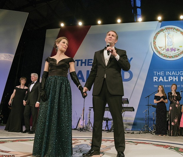 With his wife, Pam Northam, at his side, Gov. Ralph S. Northam addresses the crowd at the inaugural ball Saturday night before leading his wife in a dance around the floor. Behind him are, at left, Attorney General Mark R. Herring and his wife, Laura, and, at right, Lt. Gov. Justin E. Fairfax and his wife, Cerina.