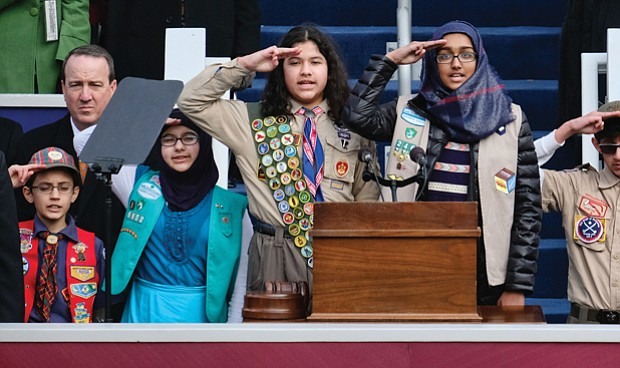 Members of the ADAMS Center Muslim Boy and Girl Scouts and Cub Scouts of Dulles led the inaugural crowd in the Pledge of Allegiance.