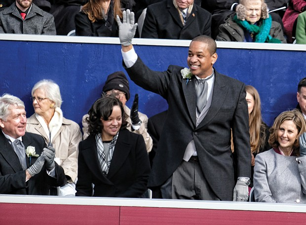 Lt. Gov. Justin E. Fairfax, only the second African-American to be elected to statewide office in Virginia, waves to a cheering crowd after taking the oath of office. His wife, Dr. Cerina Fairfax, a dentist, seated at left, held the Bible while their two children watched. Seated with him on the platform are, from left, Attorney General Mark R. Herring, Pam Northam and her husband, Gov. Ralph S. Northam.