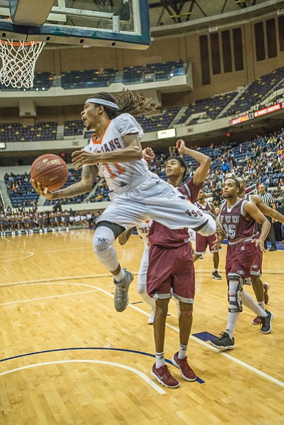 Virginia State University's Cyonte Melvin takes it to the hoop at the Freedom Classic Festival game Sunday against rival Virginia Union University at the Richmond Coliseum.