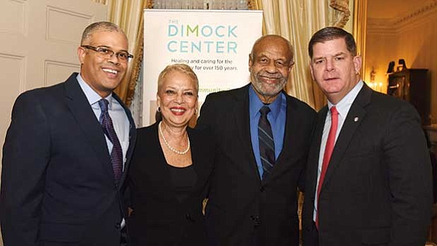 Mayor Martin Walsh celebrates the work of Flash Wiley as he steps down as board chair from the Dimock Community Health Center. (l-r) Pratt Wiley, Beneree Wiley Flash Wiley and Walsh.