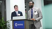 Ryan Hutchins, senior VP of Gilbane Building Company, listens as Henry Nsang, a superintendent with Janey Company, describes how contract opportunities with Gilbane helped advance Janey Company's capacity.