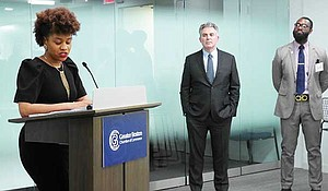 Sheena Collier, Greater Boston Chamber of Commerce director of economic opportunity, speaks at the launch of the Pacesetter initiative. Looking on are (l-r) Chamber President and CEO James Rooney and Henry Nsang of Janey Company.