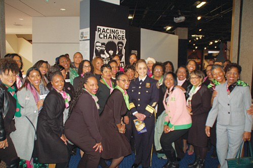 New Portland Police Chief Danielle Outlaw, the first African American woman to lead the Portland Police Bureau, draws support from members of her Alpha Kappa Alpha sorority, the oldest African American female sorority in the U.S., after taking a ceremonial oath of office Monday in front of the Oregon Historical Society's new civil rights exhibit 'Racing for Change, Oregon's Civil Rights Years.'  Outlaw challenged the city and law enforcement to address racial inequities during her address.