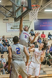 Dominique Finney, a 6-foot-5 junior at Armstrong High School, goes up for a basket at Tuesday night's game against Hanover County's Lee-Davis High School.
