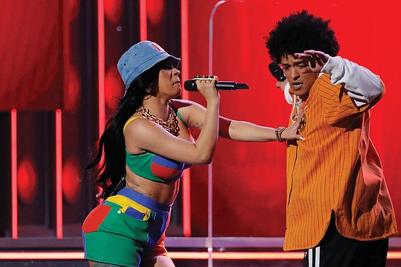 R&B artist Bruno Mars won the top prize at the Grammy Awards on Sunday in another victory for pop-driven music ...