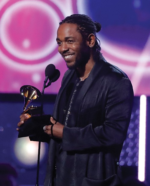 "Below, Kendrick Lamar accepts the Grammy for best rap album for ""DAMN."""