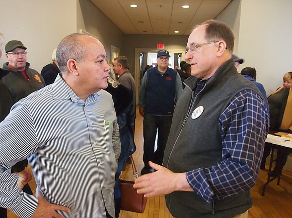 Democratic Party activists entering the Ward 18 caucus in the Hyde Park Municipal Building Saturday ran a gauntlet of clipboard-bearing ...