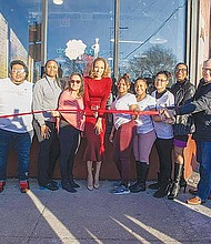 """Nichelle Benford (pictured center) celebrated her """"second chance"""" at the recent grand opening of Dream Chef Kitchen Restaurant & Catering, located on 611 S. California, with staff and community partners. Photo Credit: Chicago Neighborhood Initiatives (CNI)"""