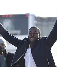 Philadelphia Eagles wide receiver Nelson Agholor gestures while walking over to a fence where fans gathered to welcome the team Monday, Feb. 5, 2018, in Philadelphia a day after defeating the New England Patriots in Super Bowl 52. (AP Photo/Julio Cortez)