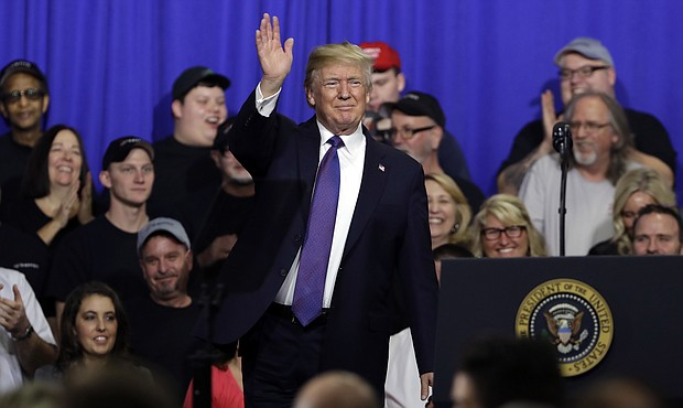 President Donald Trump waves after speaking on tax policy during a visit to Sheffer Corporation, Monday, Feb. 5, 2018, in Blue Ash, Ohio. (AP Photo/Evan Vucci)