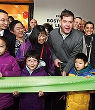 Mayor Martin Walsh and the Chinatown community celebrate the opening of a BPL Chinatown Branch opening with a ceremonial Ribbon Cutting.