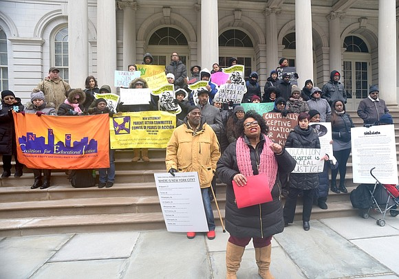 Public school parents from the New York City Center for Education Justice delivered more than 20,000 petition signatures and a ...