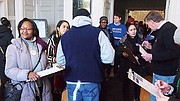 Democrats run a gauntlet of signature-gatherers as they enter the Hyde Park Municipal Building.