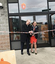 A ribbon cutting ceremony marks the merger of two community-driven banks as the former Albina Community Bank becomes the newly named Beneficial State Bank branch on Northeast Martin Luther King Jr. Boulevard.  Pictured are Randell Leach, president and chief operating officer of Beneficial State Bank, and Kat Taylor, the bank's co-founder and chief executive officer,