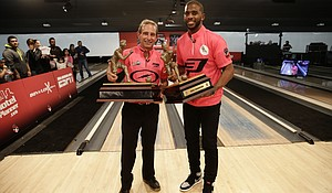 Chris Paul and Norm Duke with championship trophy.
