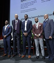 """In this Jan. 24, 2017, file photo, Kareem Abdul-Jabbar, third from left, joined by former and current professional athletes, from left, Jim Brown, Takeo Spikes, Chris Webber, Anquan Boldin and Tommie Smith, pose for photos alongside Dr. Harry Edwards after a sports and activism panel entitled """"From Protest to Progress: Next Steps"""" in San Jose, Calif. Abdul-Jabbar boycotted the 1968 Summer Olympics. At the same games, held in Mexico City, American track athletes Tommie Smith and John Carlos held raised fists covered in black leather gloves as the national anthem played after winning gold and bronze medals in the 200-meter race. (AP Photo/Marcio Jose Sanchez, File)"""