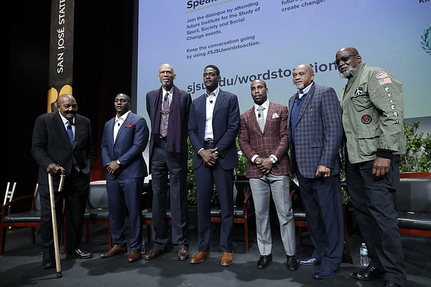 "In this Jan. 24, 2017, file photo, Kareem Abdul-Jabbar, third from left, joined by former and current professional athletes, from left, Jim Brown, Takeo Spikes, Chris Webber, Anquan Boldin and Tommie Smith, pose for photos alongside Dr. Harry Edwards after a sports and activism panel entitled ""From Protest to Progress: Next Steps"" in San Jose, Calif. Abdul-Jabbar boycotted the 1968 Summer Olympics. At the same games, held in Mexico City, American track athletes Tommie Smith and John Carlos held raised fists covered in black leather gloves as the national anthem played after winning gold and bronze medals in the 200-meter race. (AP Photo/Marcio Jose Sanchez, File)"