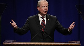 Phil Murphy gives his address after being sworn in as governor of New Jersey during his inauguration in Trenton. New Jersey is emerging as one of more than a dozen states to challenge President Donald Trump's policies on a number of issues, from taxes to immigration. Murphy's administration has been in office for barely a month after succeed Chris Christie, but he has been rolling out new lawsuits regularly. (AP Photo/Julio Cortez)