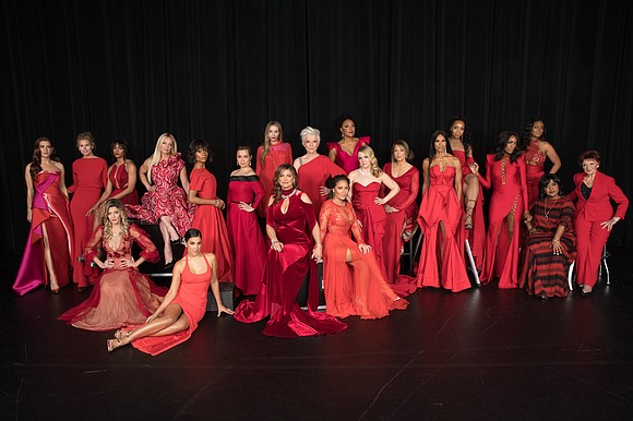 Red dresses, heart signs and dance steps all traveled down the runway Thursday night as celebrity models showed their support ...