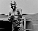 In this 1932 file photo, boxer Jack Johnson, the first black world heavyweight champion, poses in New York City. (AP Photo/File)