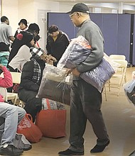 Thornton Township recently held their first winter goat give away at the Town Hall in South Holland. The event was for residents of Thornton Township and offered 400 brand new coats for children and adults at no cost. Photo Credit: Katherine Newman