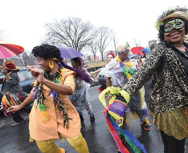 Mardi Gras style // Dogtown Dance Theatre in South Side gets the fun going during the 7th Annual Mardi Gras RVA celebration last Saturday. Members of Claves Unidos dance group kicked off the festivities with a Mardi Gras parade along five blocks in Manchester. Bringing the New Orleans style are, from left, Shalandis Wheeler Smith, Carolyn Jackson and Christina Irby.