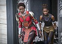 """Lupita Nyong'o, left, and Letitia Wright in a scene from Marvel Studios' """"Black Panther."""" (Matt Kennedy/Marvel Studios-Disney via AP)"""
