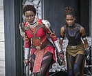 "Lupita Nyong'o, left, and Letitia Wright in a scene from Marvel Studios' ""Black Panther."" (Matt Kennedy/Marvel Studios-Disney via AP)"
