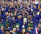 In this Saturday, May 7, 2016 file photo, students cheer as President Barack Obama delivers the commencement speech during the 2016 Howard University graduation ceremony in Washington. (AP Photo/Jose Luis Magana, File)