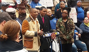 Ja Rule speaks at a rally with NYCHA residents in front of city hall