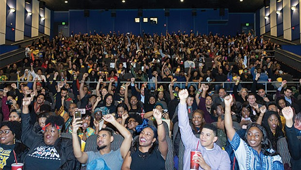 A crowd of 500 young Black professionals gathered at Regal Cinema in Fenway for the opening night event for Black Panther.