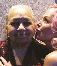 Longtime Portland civil rights leader Kathleen Saadat (left) gets some love from Portland singer Storm Large and the band Pink Martini.