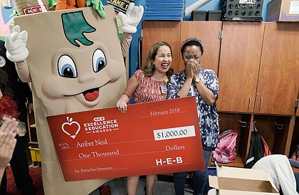 Amber Neal being surprised by H-E-B