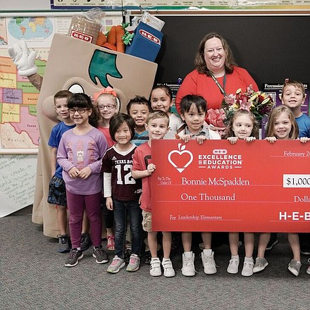 Katy ISD's Bonnie McSpadden was surprised by H-E-B