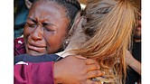 Marla Eveillard, 14, weeps as she hugs friends before the start of a vigil at Parkland Baptist Church in Florida on Feb. 15, the day after the Douglas High School massacre in which 17 people were killed and many others were wounded.