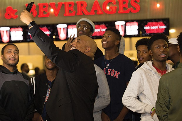 "Richmond City Councilman Michael J. Jones takes a selfie with students who accepted his challenge to perform a kind act for others and then received free tickets to last Thursday's premiere of ""Black Panther"" at Bow Tie Movieland in Richmond."