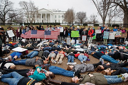 Student demonstrators stage a lie-in Monday outside the White House in Washington seeking tougher gun control laws.
