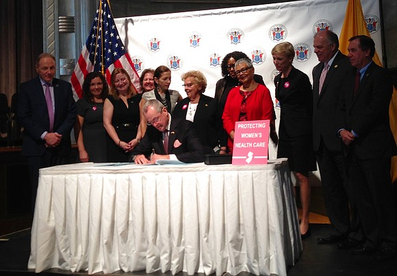 New Jersey's new Democratic governor signed legislation Wednesday setting aside about $7.5 million for family-planning and women's health, reversing course ...